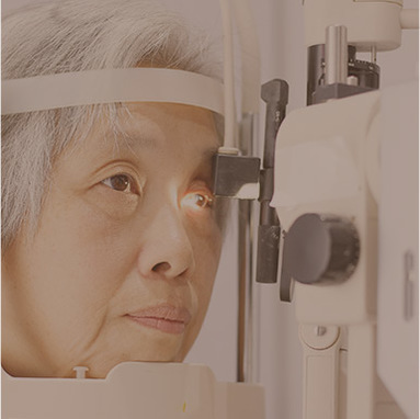 Elderly woman getting her eye exam